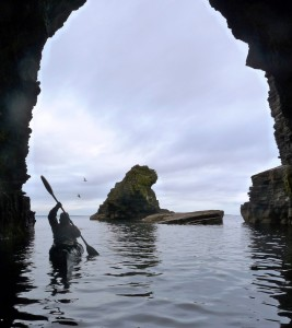 Exiting a sea cave by sea kayak