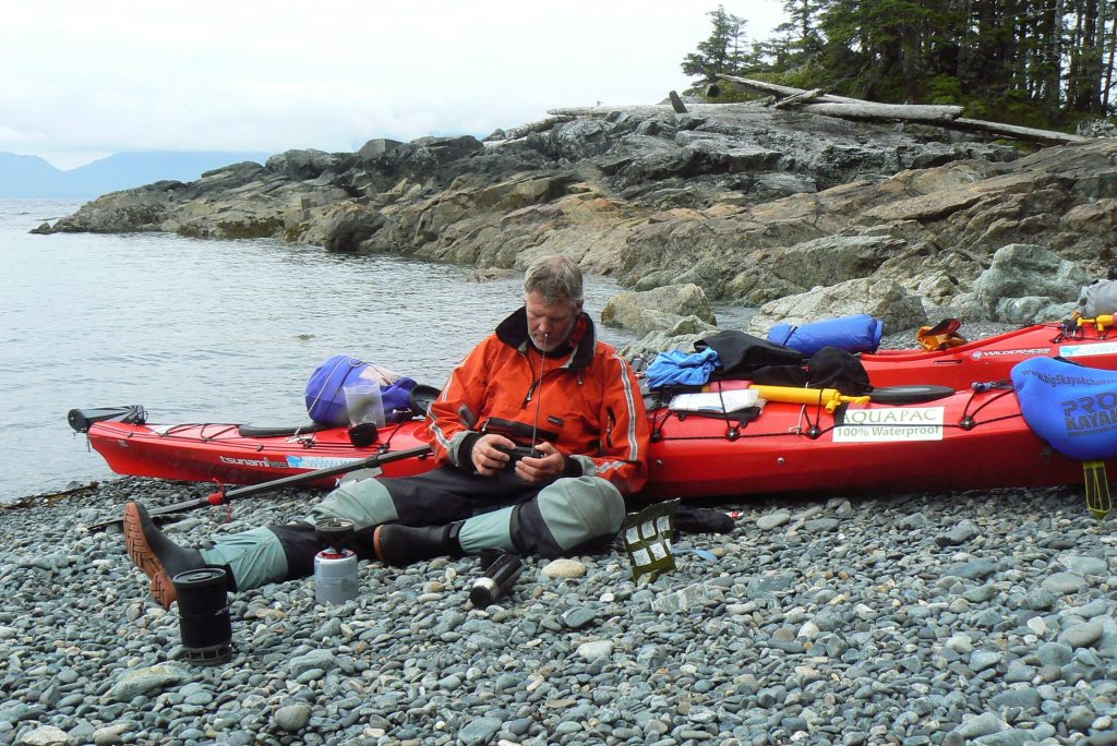 Checking the weather forecast Alaska sea kayaking
